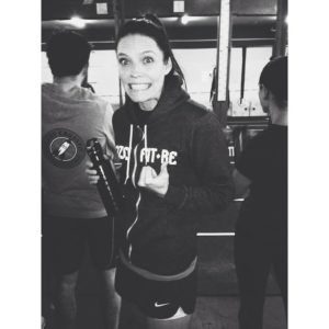 Chelsey in a CrossFit RE hoodie giving a thumbs up